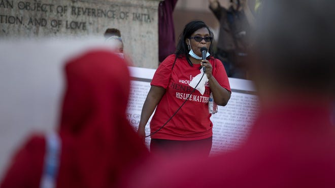 Adrienne Hood, whose 23-year-old son, Henry Green, was fatally shot by Columbus police in June 2016, speaks to a crowd outside the Statehouse after a march led by mothers of people killed by police.
