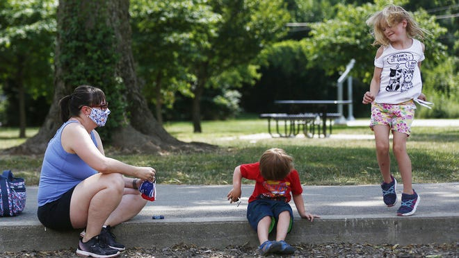 Nikki Brown Pyzik is among the parents who have quit the Clintonville MOMS Club, joining an exodus from chapters around the country after MOMS Club International refused to post an anti-racism collage. She, son Max, 4, and daughter Eleanor, 6, are at Clinton-Como Park in Clintonville, where the chapter held play dates.