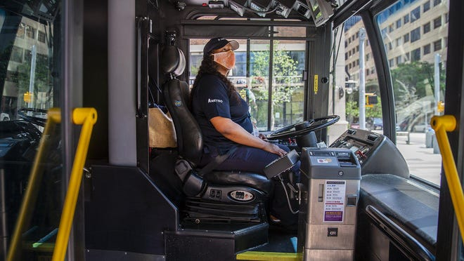 Texas Attorney General Ken Paxton issued legal opinions Tuesday stating that public transit agencies and counties can require face masks in their facilities, including buses and courthouses.