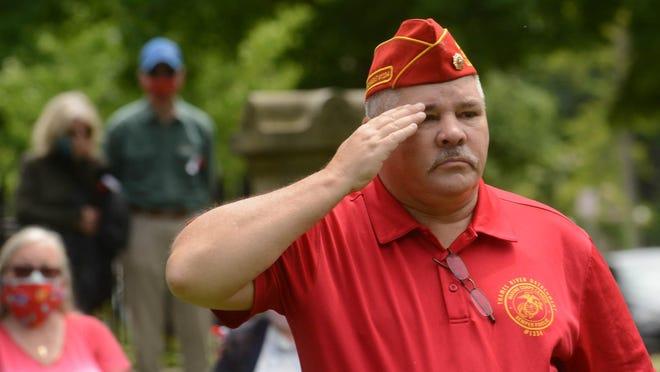 Robert Murphy salutes to honor veterans during Memorial Day ceremonies May 25, 2020.