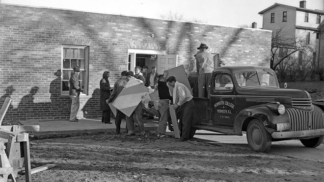 Students help move furnishings into Monmouth College's new Rotary Hall in November 1946.