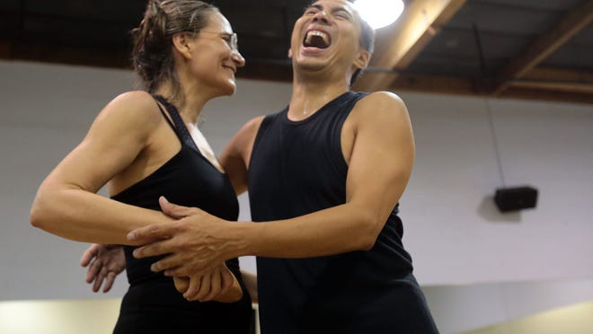 Desert Magazine editor Mary Silverman laughs after rehearsal with professional dancer Dennis Gimenez on Wednesday, November 5, 2014 in Palm Springs, Calif. The pair, who are performing samba and paso doble numbers, are competing in the 4th Annual Dancing with the Desert Stars event on November 14. The event benefits 100 Women at Desert AIDS Project.