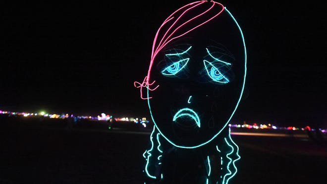Images of Burning Man participants on the Black Rock Desert of Gerlach, Nevada August 27, 2014.