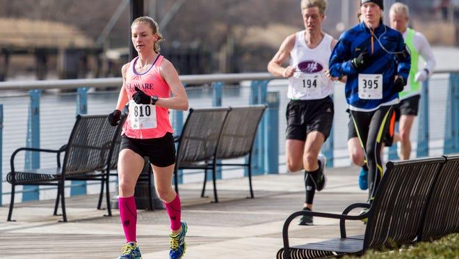 Elizabeth Swierzbinski, Delaware's top finisher in Monday's Boston Marathon, runs along the Riverfront Walk in the Caesar Rodney Half-Marathon in Wilmington in 2015.
