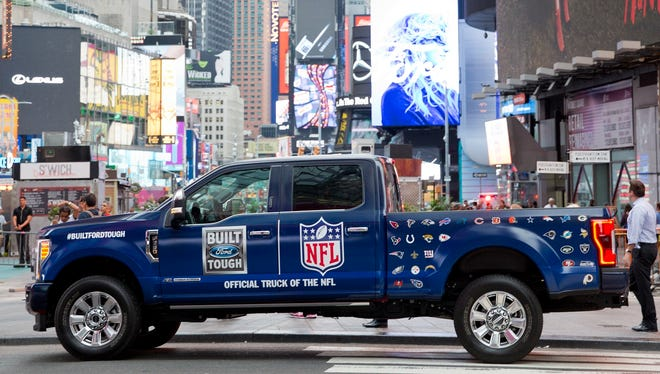 A Ford pickup shows off its NFL sponsorship affiliation in Times Square in New York.