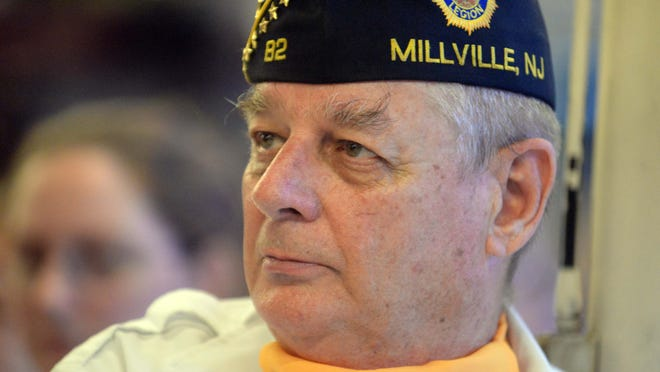 Francis Riley III, of Millville and a Vietnam veteran, watches the proceedings during a 9/11 remembrance ceremony at the Millville Fire Station on Thursday, September 11, 2014.