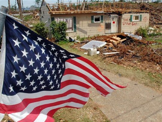 This May 2011 file photo shows an American flag flying over the remains of a tornado-ravaged neighborhood in Tuscaloosa, Ala., a month after a killer storms in Alabama. Oklahoma and Kansas may have the reputation as tornado hotspots, but Florida and the rest of the Southeast are far more vulnerable to killer twisters, a new analysis shows.
