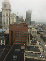 Fog shrouds the tops of buildings in Downtown Cincinnati