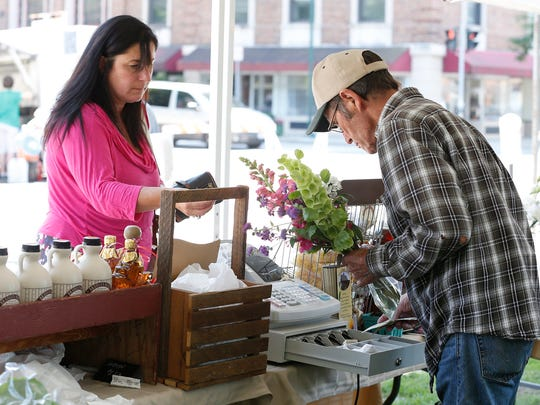 A cool breeze and sunshine welcomed Wisner Market patrons on a sunshine-filled day Thursday, July 16. A couple hundred people roamed the park as noon hit.