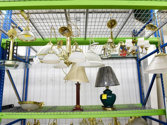 Lighting fixtures have a new display Tuesday, Feb. 2 at the Central Minnesota Habitat for Humanity ReStore.