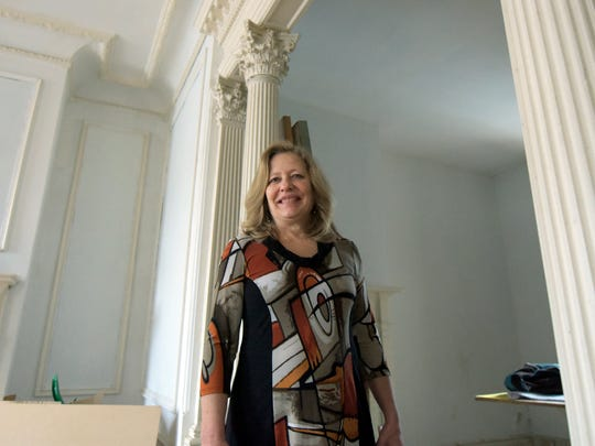 Carol Kauffman, Community Outreach Director of the Crispus Attucks Association, walks through the Goodridge House Tuesday, Feb. 23, 2016. She said she is hoping to open the first floor this May for an open house to celebrate Crispus Attucks 85th anniversary. Bill Kalina photo
