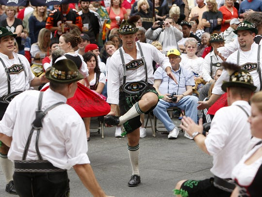 Enquirer file photos  The Donauschwaben Schuplattler Dancers entertain the crowd on Fountain Square during Oktoberfest Zinzinnati in 2011. OKTOBERFEST: Sunday, September 18, 2011: METRO/ LOCAL. The Donauschwaben Schuplattler Dancers entertain the crowd on Fountain Square during Oktoberfest Zinzinnati, on Sunday, September 18. The Enquirer/Amanda Davidson