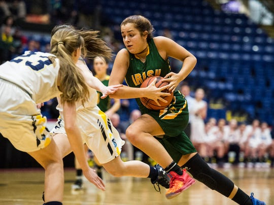 York Catholic's Kate Bauhof drives the lane as York Catholic beat St. Basil Academy 40-31 in the PIAA 3A quarterfinals at Santander Arena in Reading, Pa. on  Sunday, March 19, 2017.