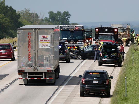 Emergency officials work the scene of a crash Tuesday
