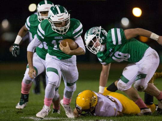 Brick's Anthony Prato (12) gains yards on the ground on Friday, Oct. 27, 2017.