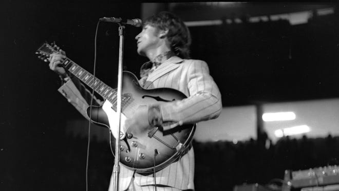 John Lennon of The Beatles performs at Detroit's Olympia Stadium on August 13, 1966. This was the last time The Beatles performed in Detroit.