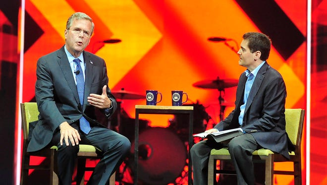 Jeb Bush, left, speaks with Russell Moore during a Southern Baptist Convention event on Tuesday at Bridgestone Arena in Nashville.