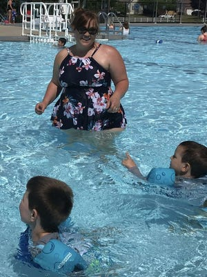 Laura Shank of Pickerington, swims June 17 with her sons, 5-year-old, Henry (left) and Oliver, 4, in the Pickerington Community Pool. City officials said they are pleased, overall, with attendance and the format pool officials used this year.