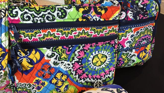 "Vera Bradley handbags with the ""Rio"" pattern are shown on Monday, July 27, 2015. Rio, one of Indiana-based company's patterns released as part of their 2015 spring collection, will be used by USA Gymnastics for medalist ribbons at the P&G Gymnastics Championships in Indianapolis August 13-16, as well as for signage and on participating athletes' bibs. The 2016 Olympic Games will be held in Rio de Janeiro. The country's top gymnasts will be in Indianapolis next month vying for the national team and spots on the 2015 World Championships team."