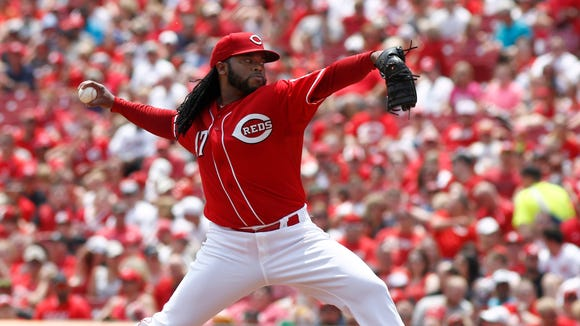 Reds starting pitcher Johnny Cueto throws the ball in the third inning on June 7.