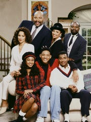 THE FRESH PRINCE OF BEL-AIR -- Season 4 -- Pictured: (l-r) Back: Karyn Parsons as Hilary Banks, James Avery as Philip Banks, Daphne Reid as Vivian Banks, Joseph Marcell as Geoffrey; Front: Tatyana Ali as Ashley Banks, Will Smith as William 'Will' Smith, Alfonso Ribeiro as Carlton Banks  (Photo by Chris Haston/NBC/NBCU Photo Bank via Getty Images)