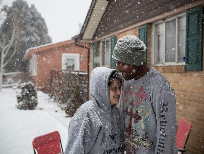 Former Army specialist Levertis Jackson and his wife, Rebecca, share a quiet and snowy moment after stepping out of their home in Colorado Springs.