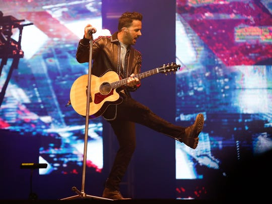 Puerto Rican singer-songwriter Luis Fonsi performs in Quito, Ecuador.