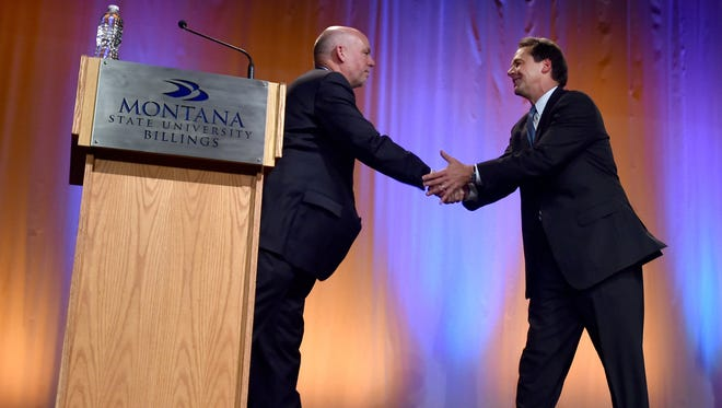 Gubernatorial candidates Greg Gianforte, left, and Steve Bullock , right, shake hands after the Montana Gubernatorial Debate on Monday.