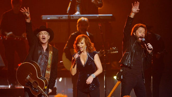 Kix Brooks and Ronnie Dunn performs with Reba McEntire during the 49th annual CMA Awards at Bridgestone Arena in Nashville in 2015.