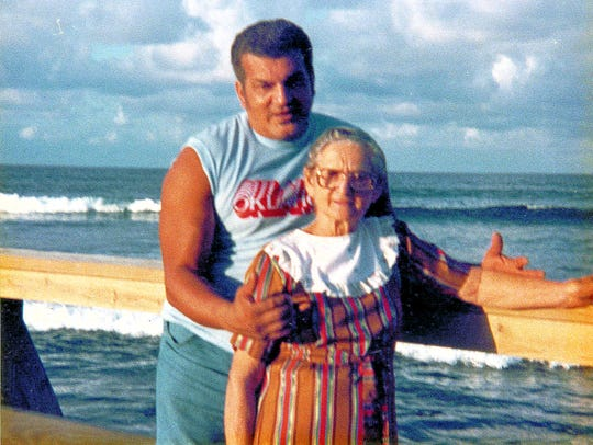 Carlos Gracias and his adoptive mother, Blanca Rosa Colon, on the beach in Puerto Rico is from the mid-1980s.