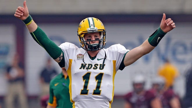 North Dakota State quarterback Carson Wentz warms up before a game against Montana on Aug. 29, 2015.