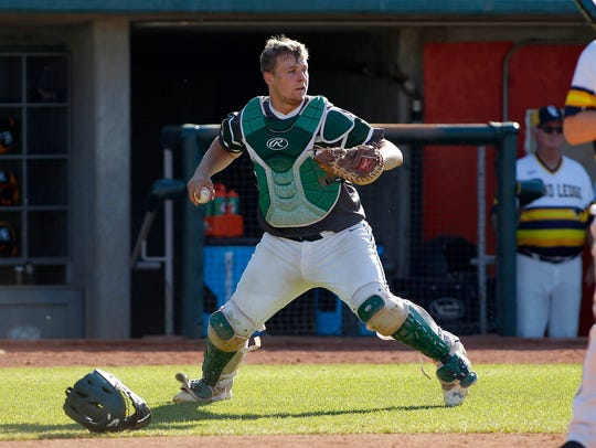 Williamston catcher Austin Stiffler looks to cover