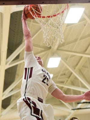 Andrew Bench cranks home a dunk in the fourth quarter as Genoa slammed the door on a share of the Northern Buckeye Conference crown.