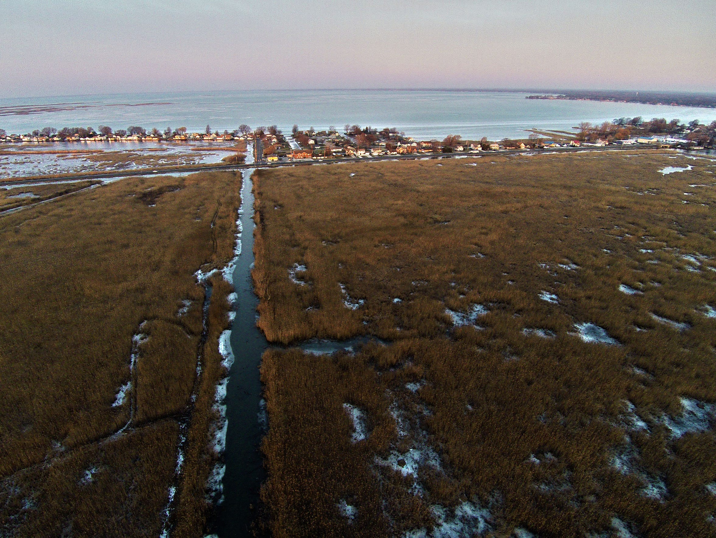 An aerial shot of St. Johns Marsh with M-29 running