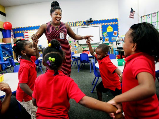 Downtown Elementary School teacher Sherry Barbee (top middle) dances with her preschool students.