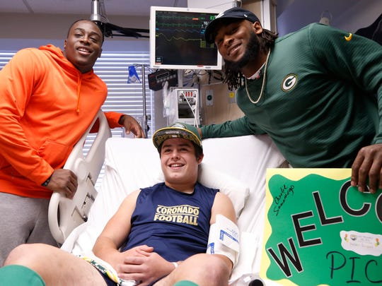 Green Bay Packer Aaron Jones, right, and his brother Alvin Jones visited patients at Las Palmas Medical Center on Wednesday. They visited patients at the Pediatric Intensive Care Unit, including Coronado High School sophomore Charlie Samaniego 16.