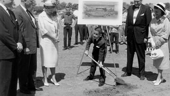 11-year-old Grady Gammage, Jr. stands in for his father, ASU President who along with Frank Lloyd Wright passed away before start of construction, at the ceremonial groundbreaking for Gammage Auditorium in 1962. Pictured l-r: President Durham; Robert E. Mc Kee, builder; Mrs. Kay Gammage; Grady Gammage, Jr.; Willam Wesley Peters, Architect; and Mrs. Frank Lloyd Wright.