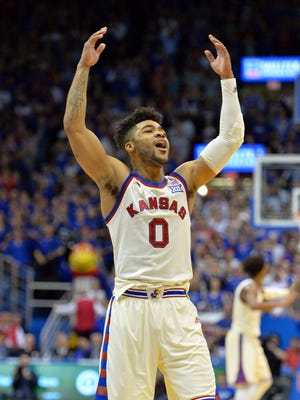 Kansas guard Frank Mason III (0) motions to the crowd in overtime against West Virginia.