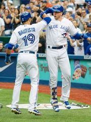 Justin Smoak (right) of the Blue Jays hit the 1,070th home run in the majors in June on Friday night, setting a mark for most round-trippers in a month.