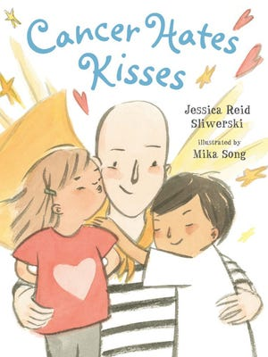 "Jessica Reid Sliwerski's book ""Cancer Hates Kisses"" depicts moms with cancer as superheroes to put their battles in terms young children can understand."