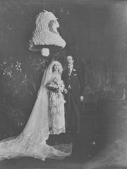 Cornelia Vanderbilt Cecil and her new husband, John Cecil, pose for a wedding photo in Biltmore's tapestry gallery.