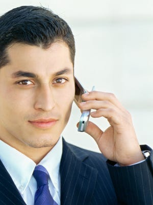 portrait of a businessman talking on a mobile phone [Via MerlinFTP Drop]