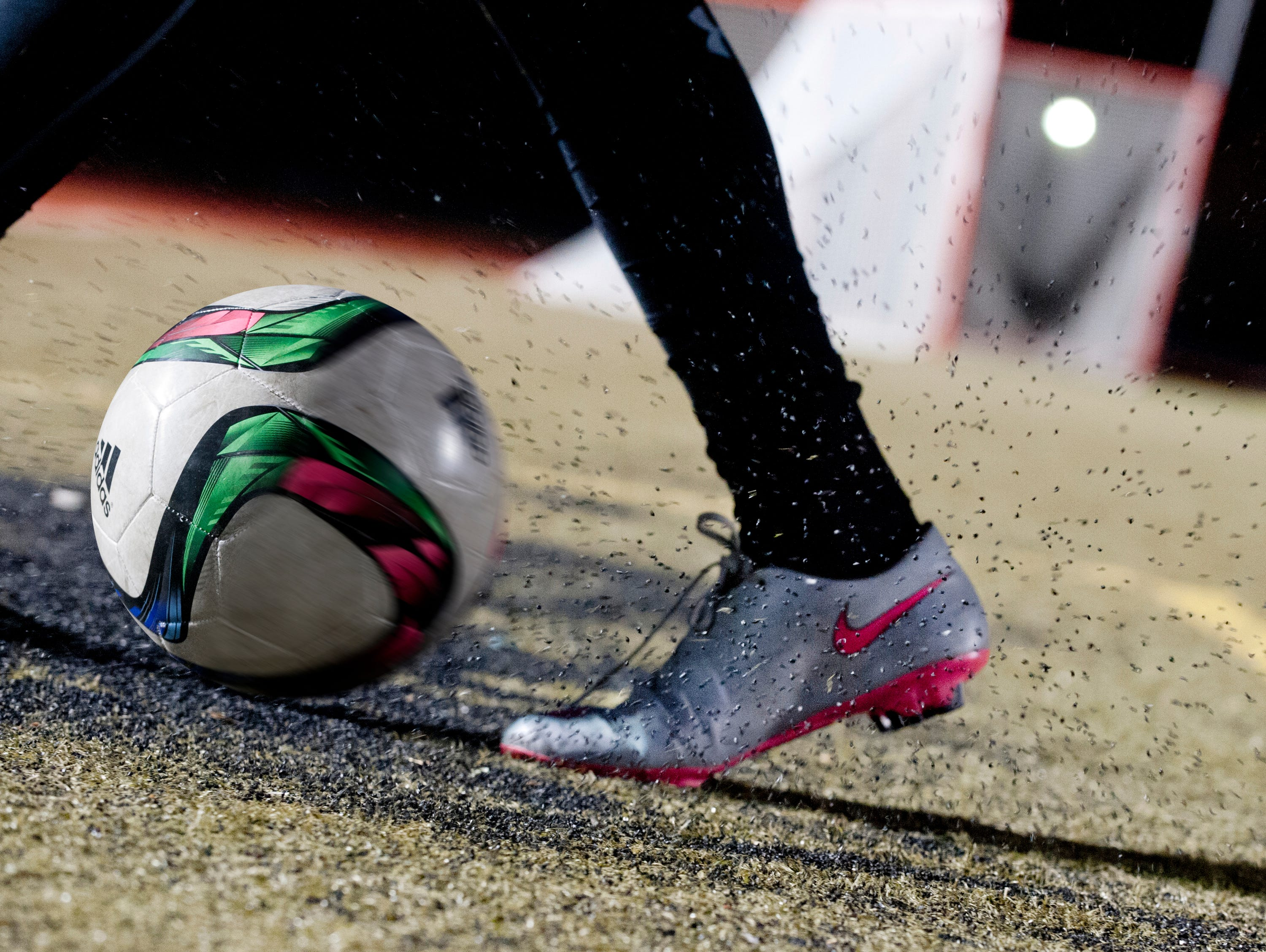 Photo illustration of rubber particles being kicked up at the St.Xavier High School soccer field. The Kentucky Players Academy was practicing there. 16 February, 2016
