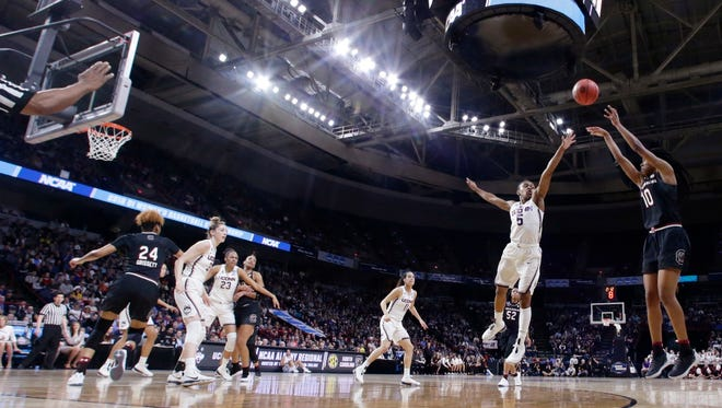 Connecticut's Crystal Dangerfield (5) defends a shot by South Carolina's Bianca Jackson (10) during the first half of a regional final at the a women's NCAA college basketball tournament Monday, March 26, 2018, in Albany, N.Y. (AP Photo/Frank Franklin II)