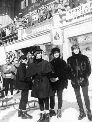 The Beatles' Ringo Starr, left, George Harrison, John Lennon and Paul McCartney, during the filming of 'Help!' in Austria in 1965. The coats worn by Starr and Harrison were sold in a Beatles memorabilia auction in Liverpool, England, in 2014.