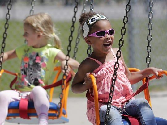 Kianna King, 5, rides the Chairplane at Bay Beach Amusement Park on Friday,