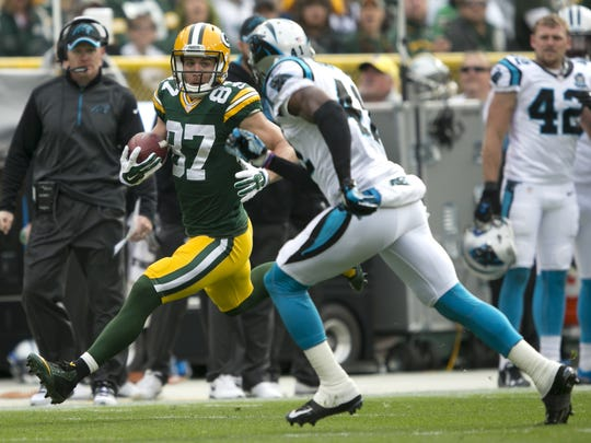 Green Bay Packers wide receiver Jordy Nelson heads for the end zone on a touchdown reception against Carolina Panthers strong safety Roman Harper in the first quarter.  The Green Bay Packers host the Carolina Panthers Sunday, October 19, 2014, at Lambeau Field in Green Bay, Wis.  Wm. Glasheen/Post-Crescent Media