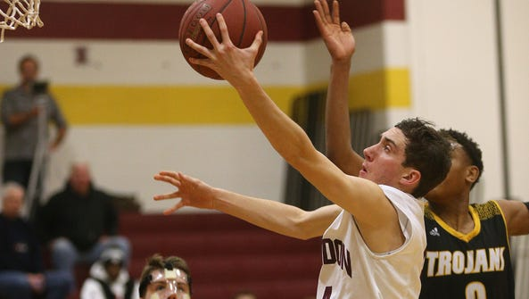 Mendon's Connor Krapf drives to the basket against