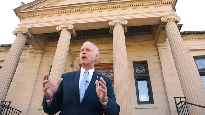 U.S. Sen. Ron Johnson, R-Wis., discusses his reasons for filing a lawsuit against the Obama administration's decision to give members of Congress and their staff subsidies to help pay for health insurance purchased on an Obamacare exchange while on the steps of the federal courthouse in Green Bay on Monday morning.