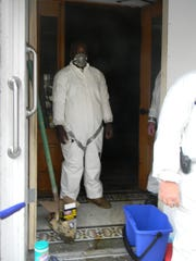 One of the half dozen cleaners the city hired to remove